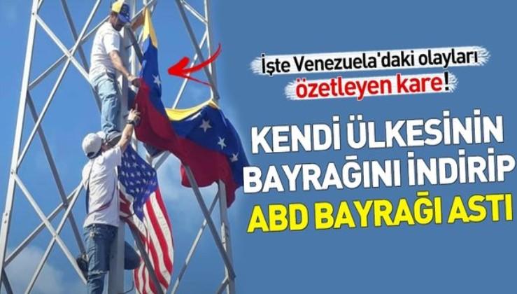 Venezuela'da Maduro muhalifleri kendi ülkesinin bayrağını indirip ABD bayrağı astı.