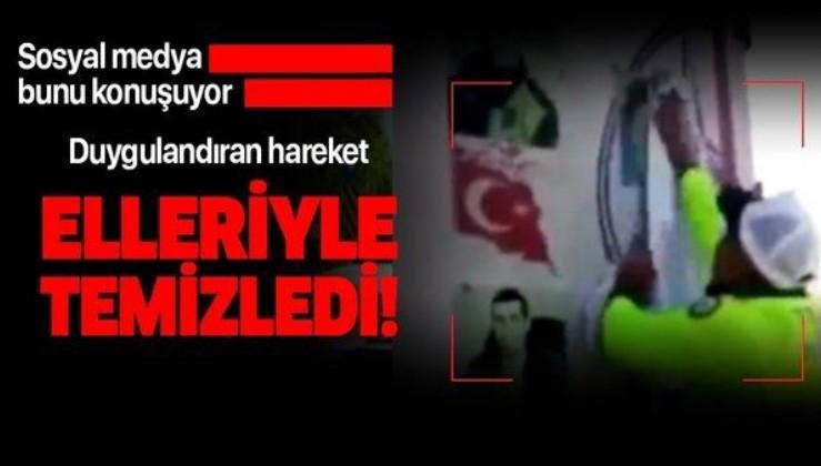 Son dakika: Sosyal medya bunu konuşuyor! Çevirme yapan trafik polisi şehit resimlerini elleriyle temizledi!