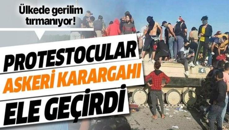 Irak'ta gerilim tırmanıyor! Protestocular askeri karargahı ele geçirdi!.