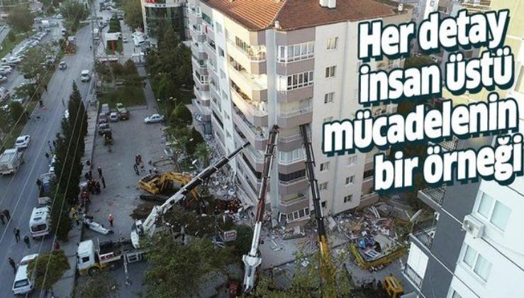 İzmir Bayraklı'da yan yatan bina 3 vinçle desteklenerek arama kurtarma çalışmaları yapılıyor