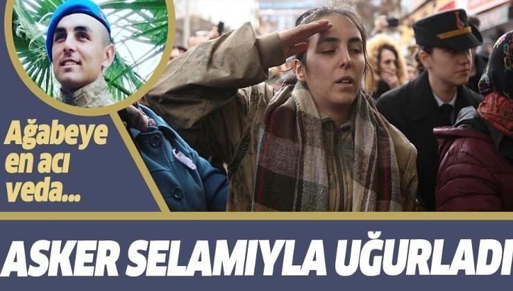 Çığ şehidi Özen Akçam'ın kız kardeşi ağabeyinin montunu giyerek asker selamı verdi