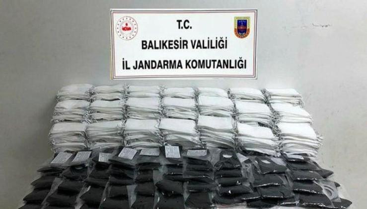 Son dakika: Kovid-19 fırsatçılarına geçit yok: Balıkesir'de kaçak üretilen 9 bin 850 maske ele geçirildi
